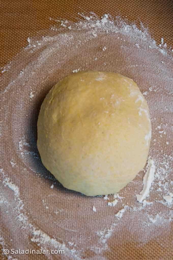 dough ball on floured surface