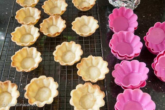 baked mini tart shells along with silicone molds