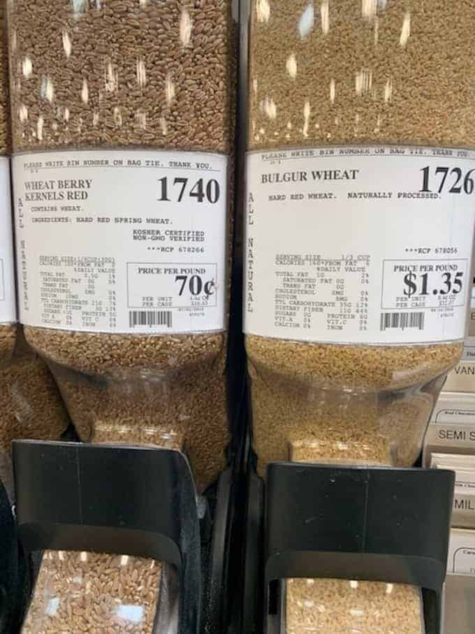 wheat berry kernels and bulgur wheat in bulk bin.