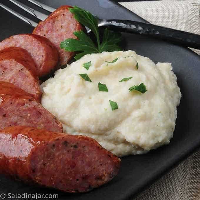 Cauliflower Creme on plate with sausage