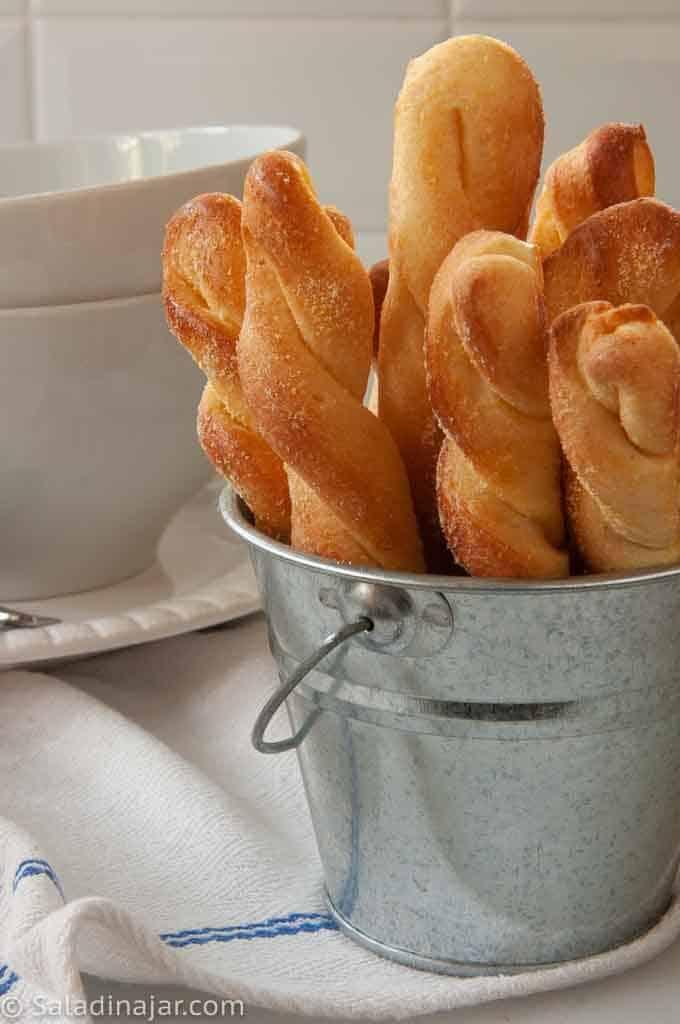 backed cornbread sticks in a bucket