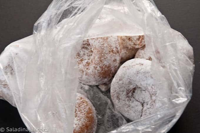 coating donuts with powdered sugar