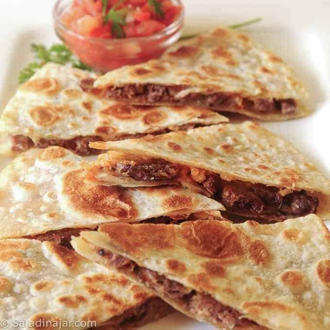 BRISKET AND PEPPER JACK QUESADILLAS served with pico de gallo