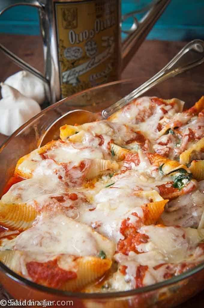 CHEESY SPINACH AND MUSHROOM STUFFED SHELLS--ready to eat in a casserole dish