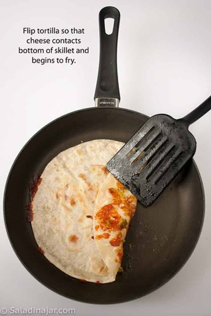 flipping tortilla in skillet