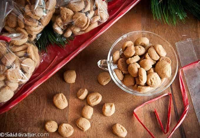 Crunchy Gingerbread Bites in a bowl along with cookies packaged for gift-giving