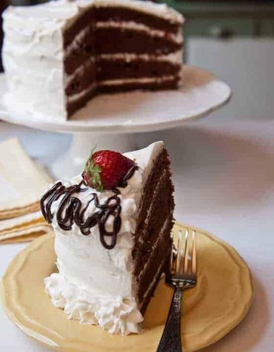 swiss chocolate layer cake with whipped cream icing