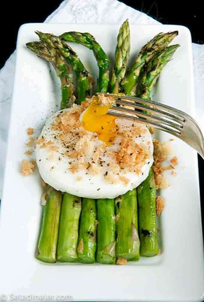 grilled asparagus with broken poached egg on top