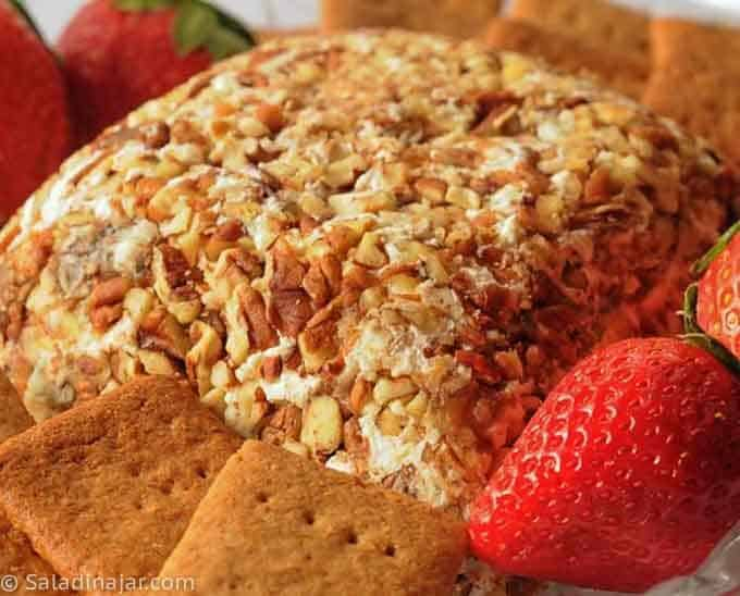 closeup Date Cheese ball-decorated with strawberries and served with homemade graham crackers.