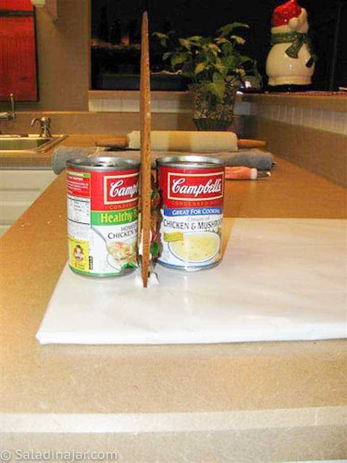 using cans to support gingerbread walls