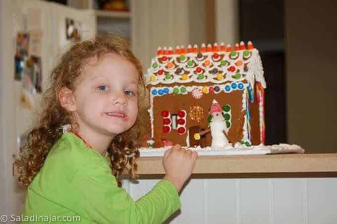 granddaughter with her gingerbread house (a simple one)