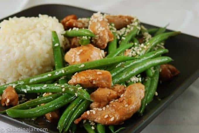 Chicken and Green Bean Stir-Fry with Sesame Seeds, on a plate with rice