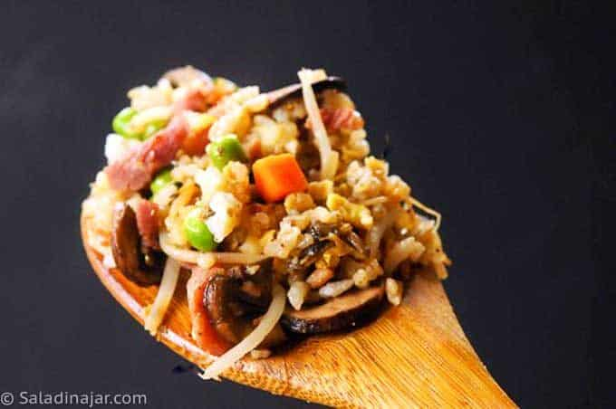 ham fried rice on wooden spoon
