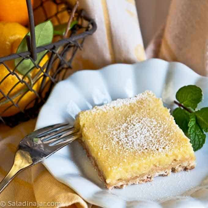 MEYER LEMON YOGURT SQUARE on plate with a fork