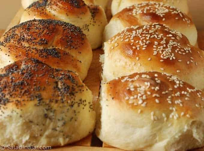 yeast rolls topped with poppy seeds and some with sesame seeds