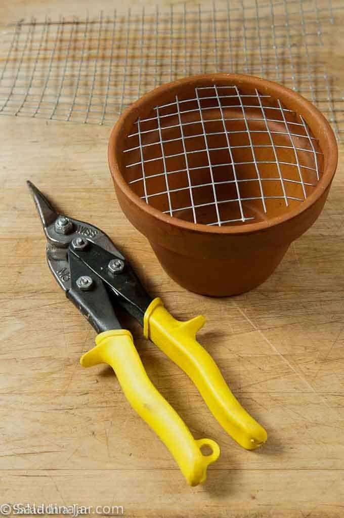 wire cutter, wire mesh and a flower pot for making a table-top marshmallow roaster