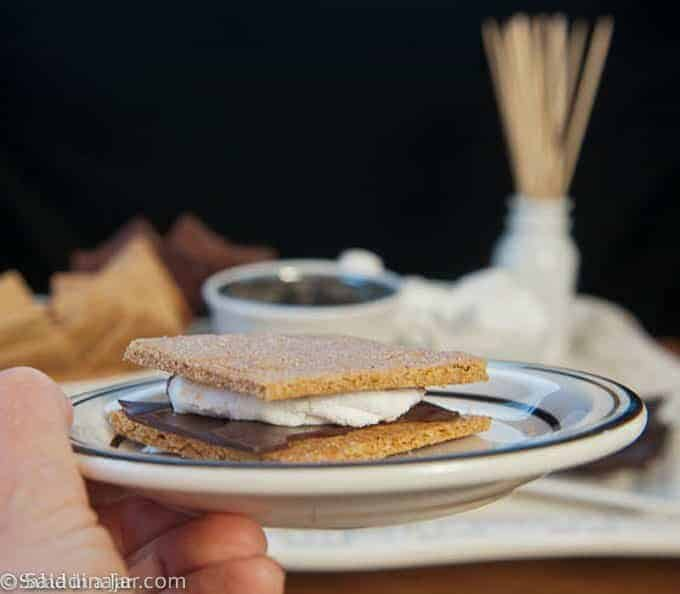 Smore on a plate with party bar in the background