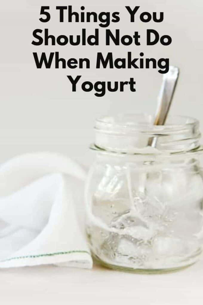 empty jar of homemade yogurt with spoon and napkin on the side