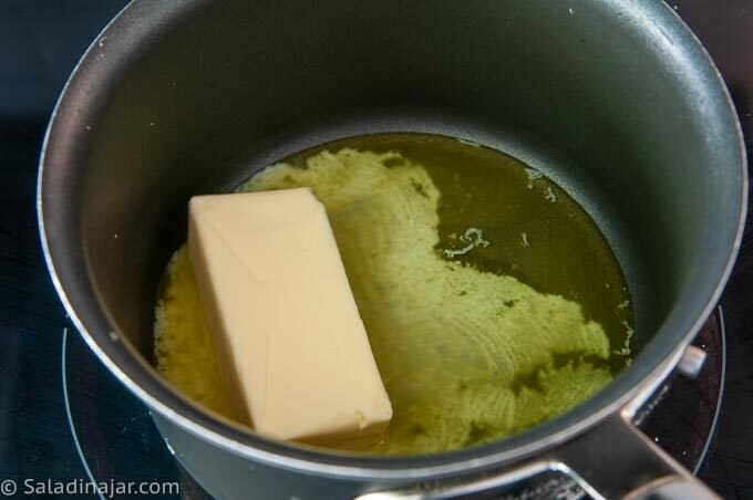 melting butter in a pan on the stove