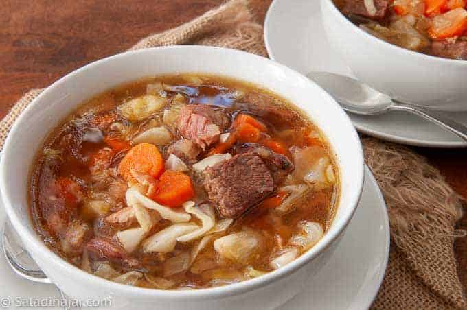 two bowls of hearty beef and cabbage stew