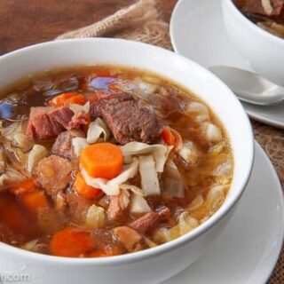 two bowls of hearty beef and ham stew