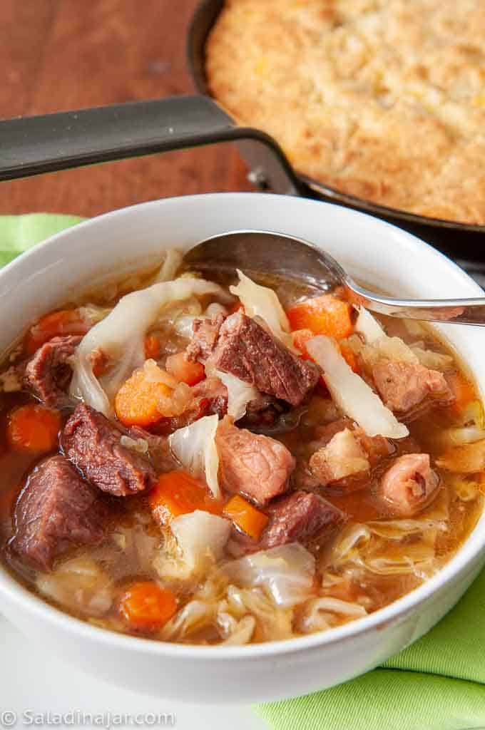 bowl of Hearty Beef and Ham Stew with cornbread
