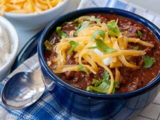 a bowl of chili with chocolate
