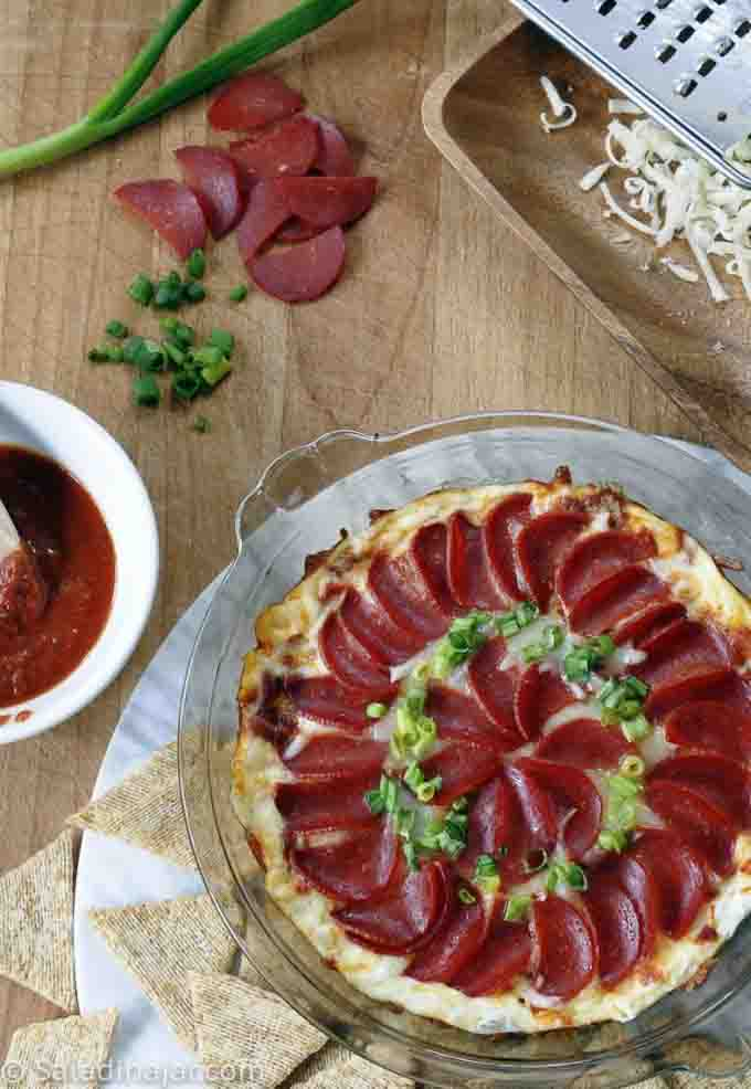 Pepperoni Pizza Dip with pepperoni green onions, grated cheese and crackers