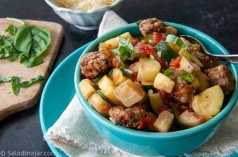 Meatball Ratatouille Soup with basil and Parmesan garnishes