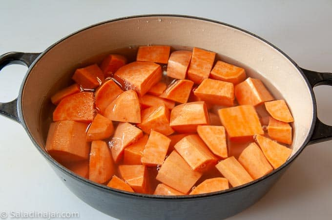 cooking sweet potatoes and white potatoes on the stove