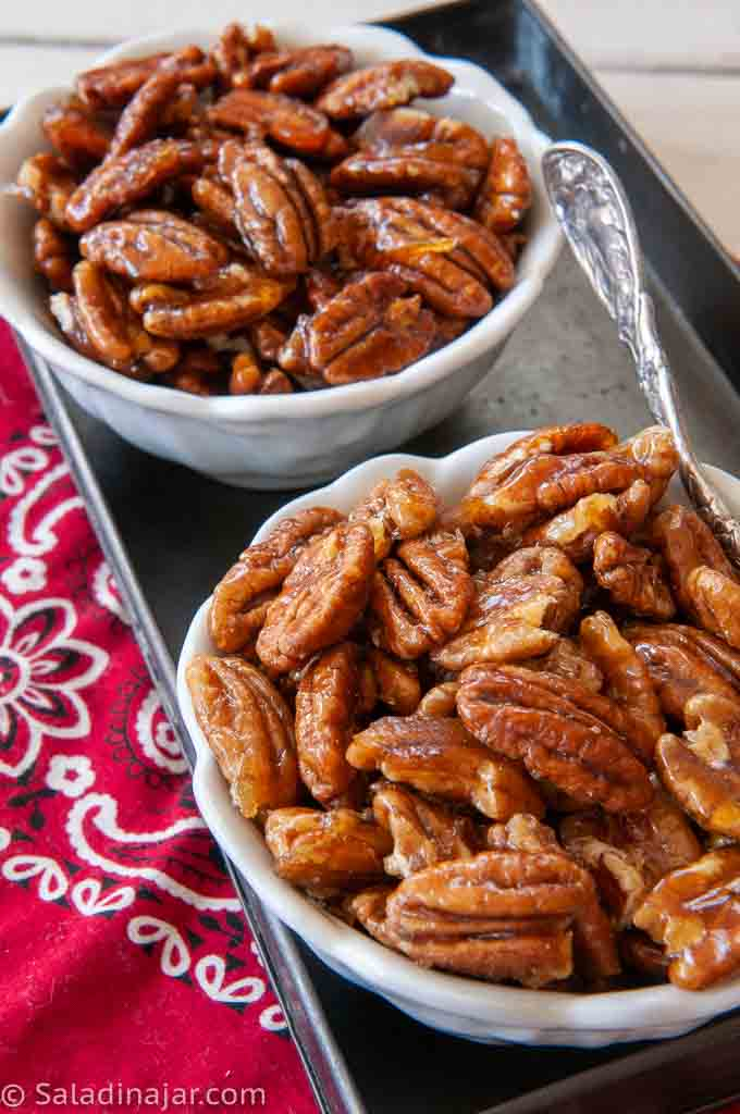 Caramelized Pecans and Cinnamon Caramelized pecans in separate dishes