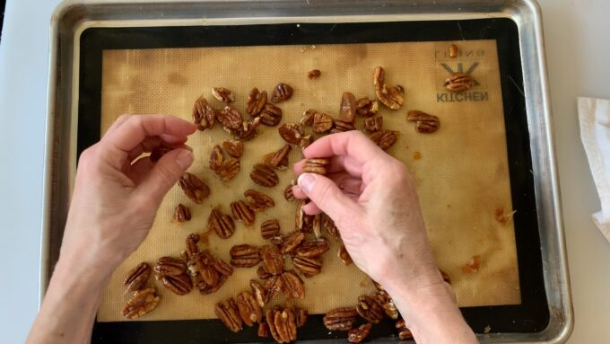 separating pecans with fingers