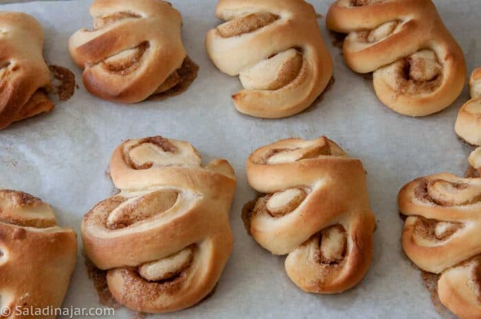 unfrosted baked Bear Claws on Cookie Sheet