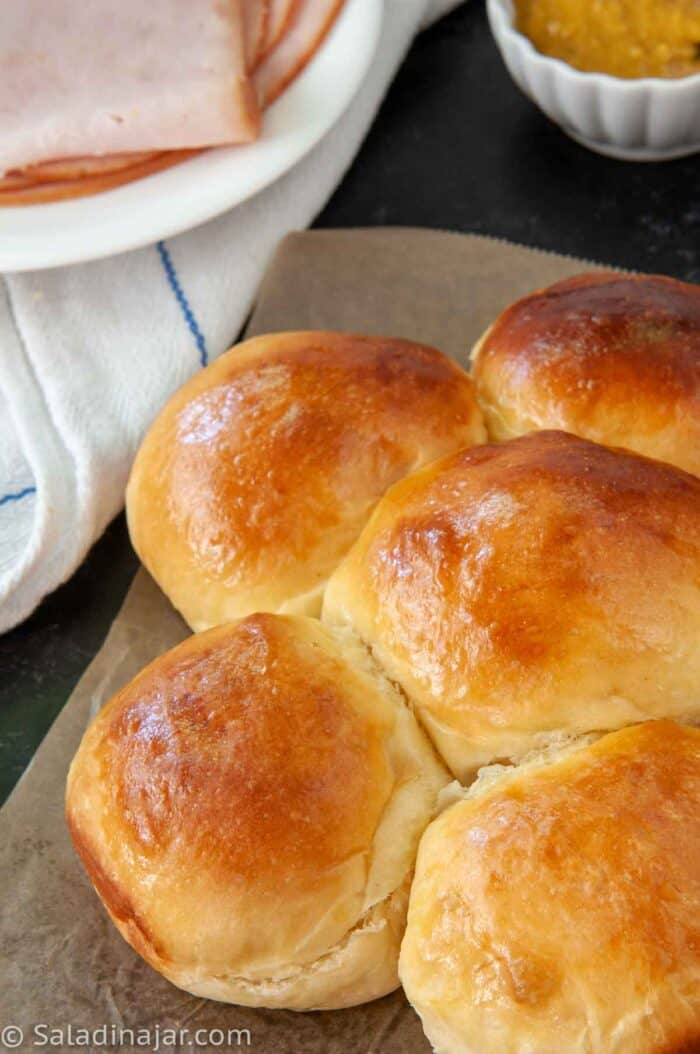 a clone recipe of King's Hawaiian Bread Rolls with sandwich makings on the side
