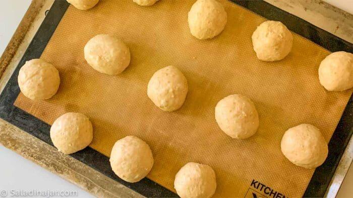 balls of dough arranged on a cookie sheet