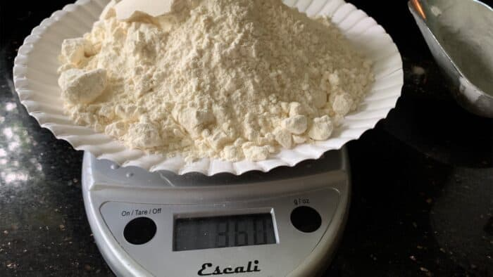weighing flour on a digital scale