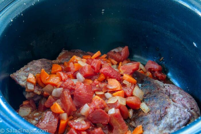 chuck steak in the crockpot with chopped veggies