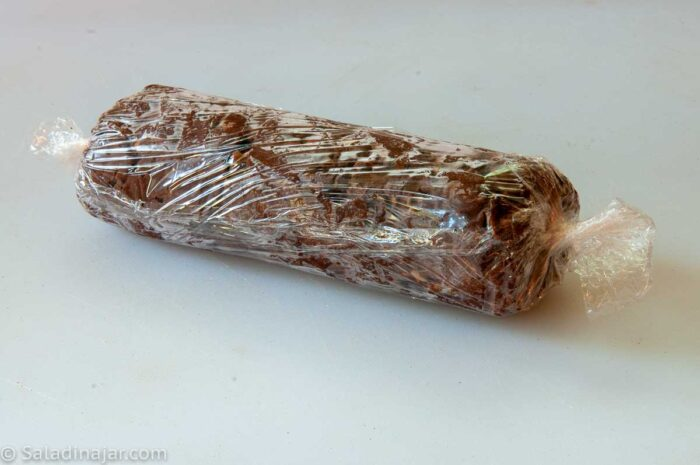 log of cookie dough wrapped to put in the refrigerator or freezer