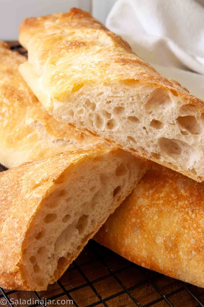 slices of ciabatta showing lots of holes and tunnels under a golden crust