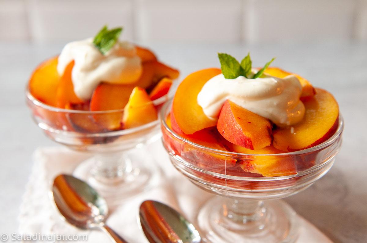crème fraîche on top of fresh peaches
