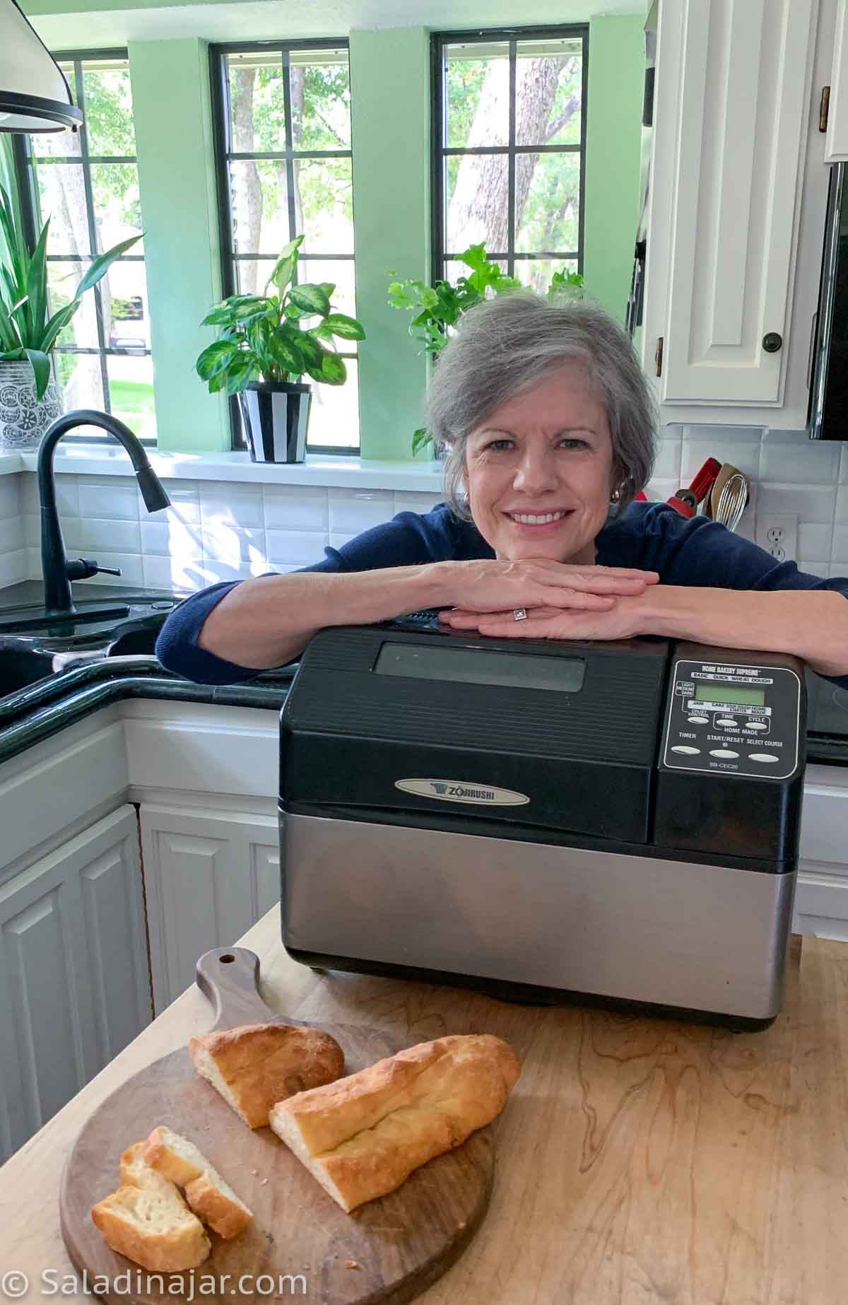 website owner with bread machine and ciabatta in her kitchen