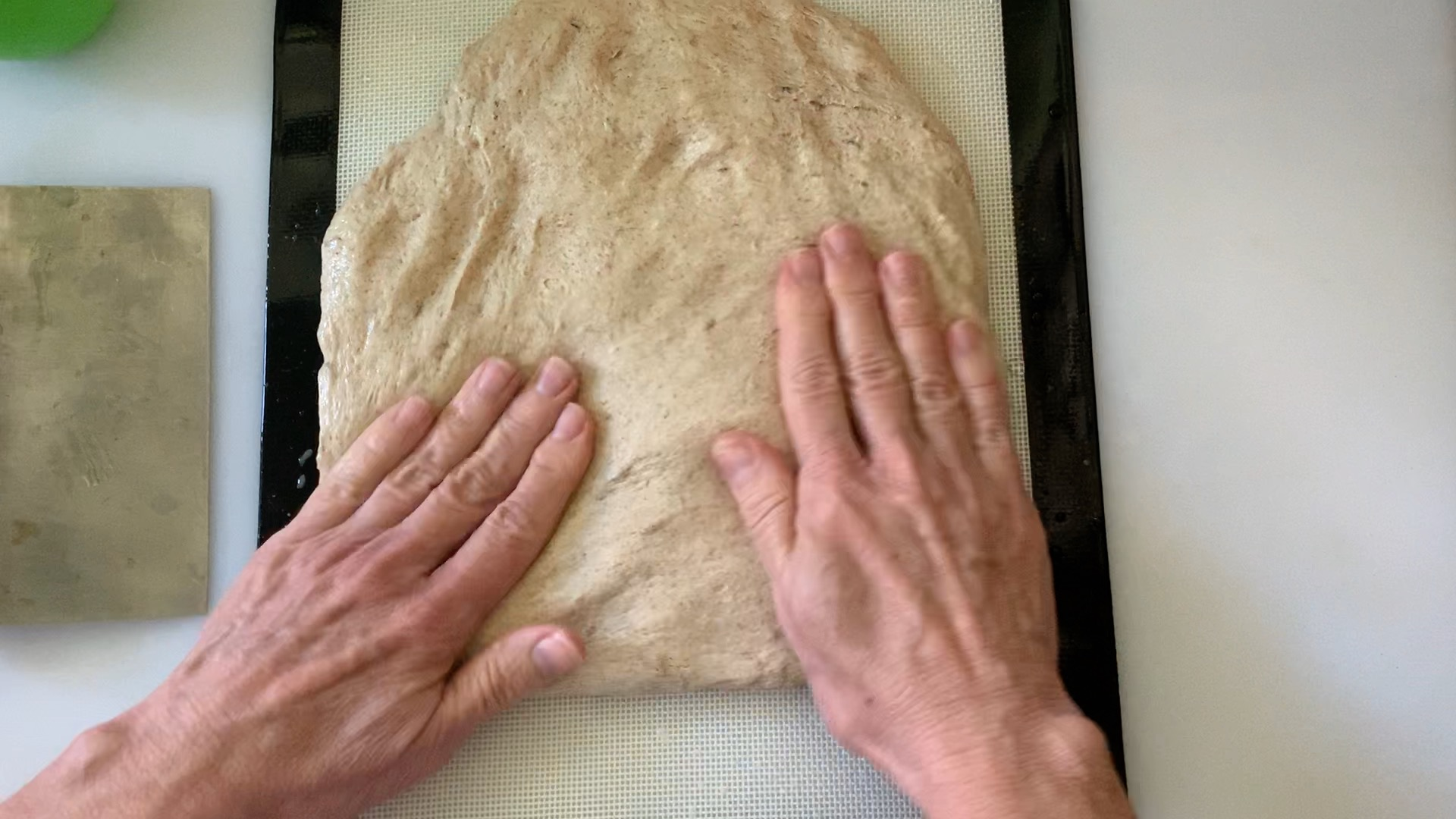 using hands to press out the dough