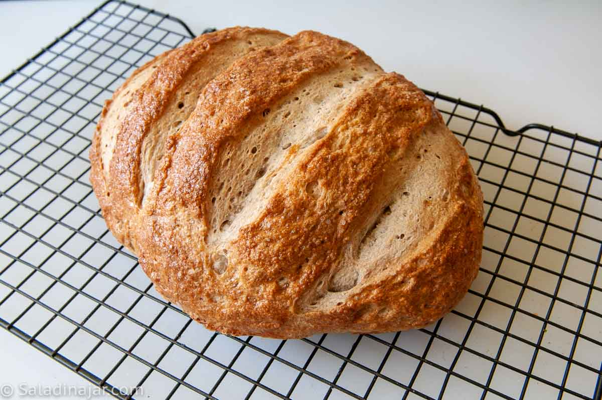 Baked Rye bread cooling on a rack