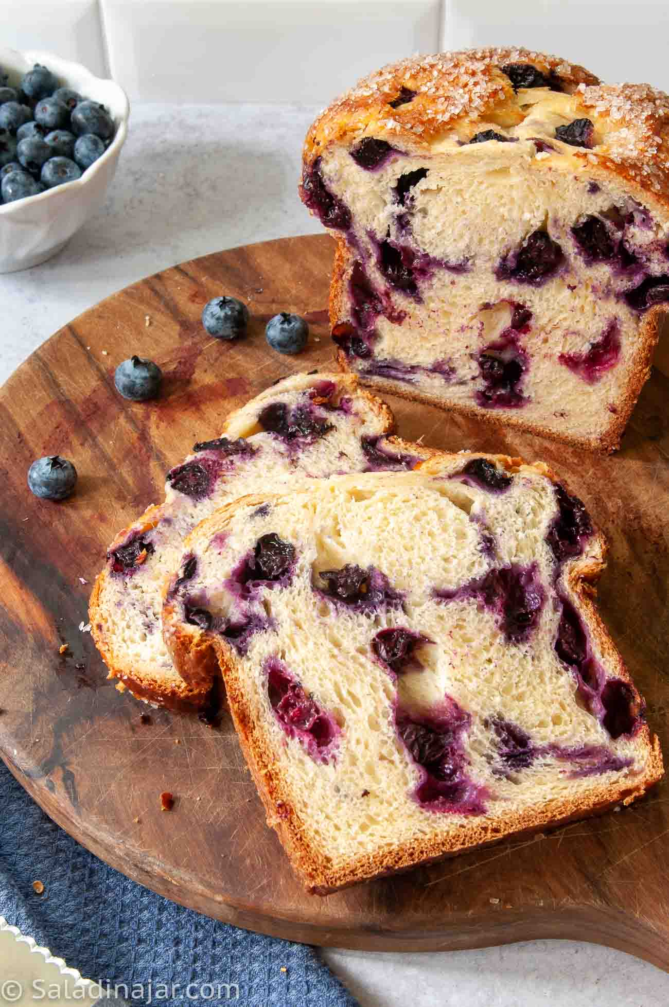 sliced sweet bread machine blueberry bread on a cutting board