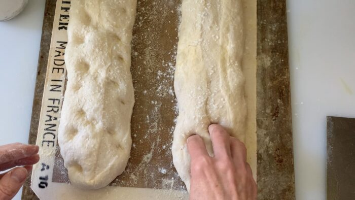 using fingers to dimple loaves