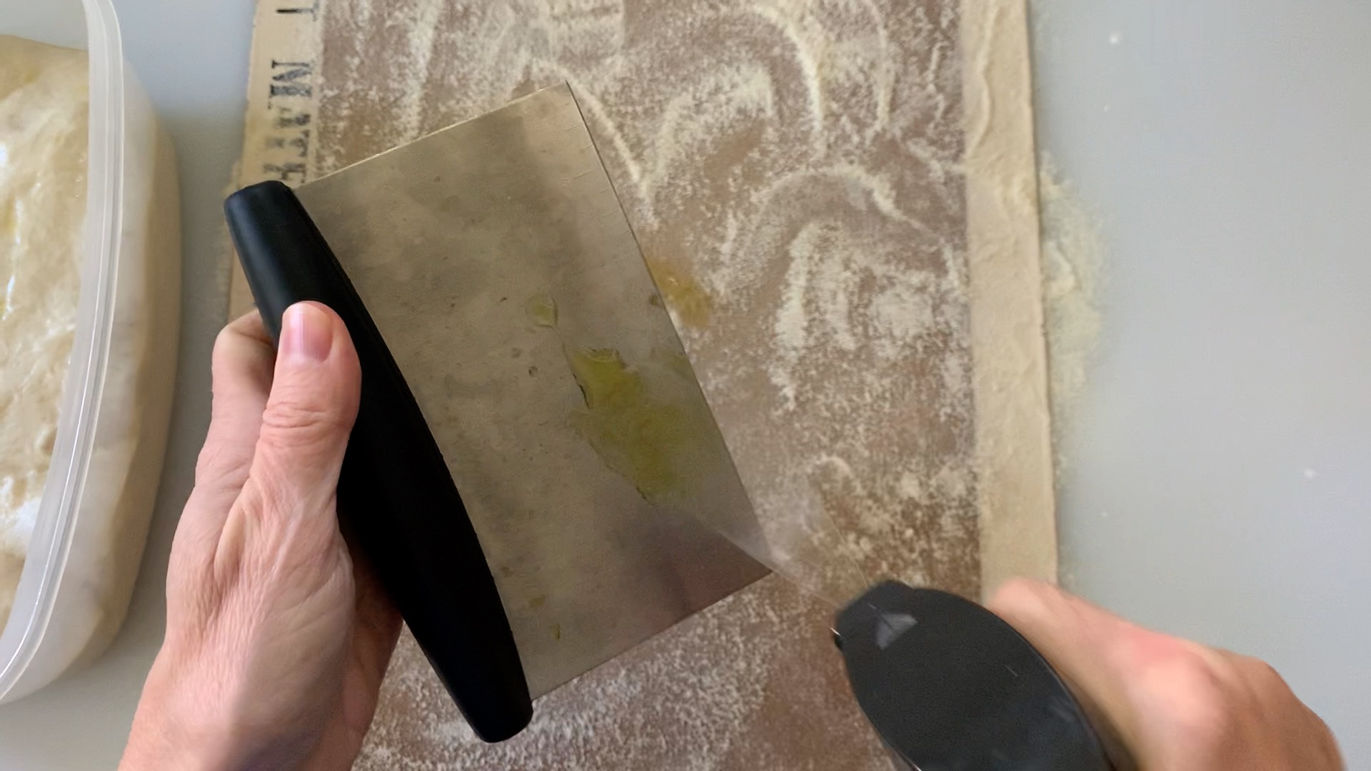 spray a bench scraper with olive oil