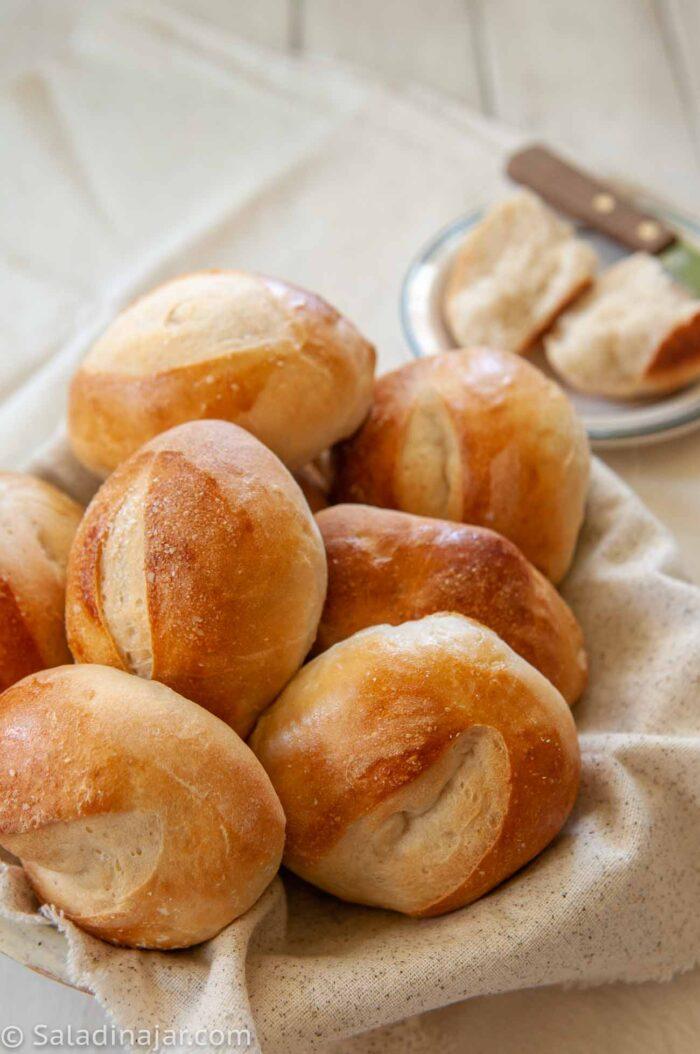 Chewy sourdough rolls in a basket