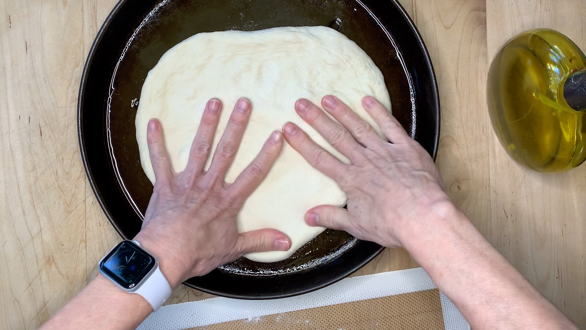 spreading the dough with your fingers