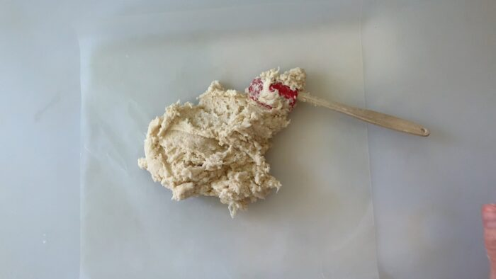 shaping dough with a spatula and wax paper
