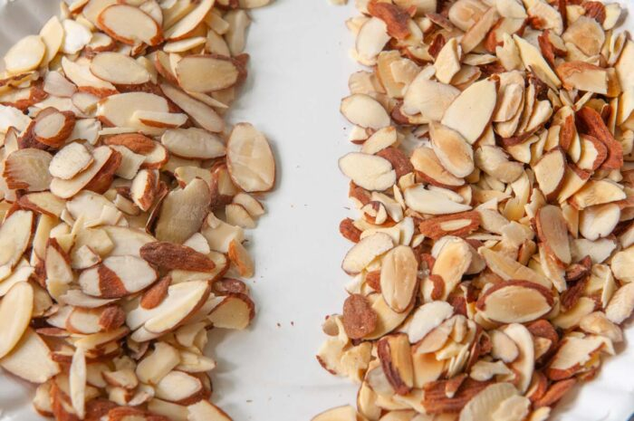 raw and microwave-toasted almonds on the right